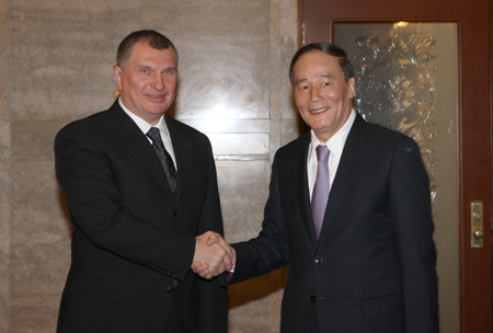Chinese Vice Premier Wang Qishan and Russian Deputy Prime Minister Igor Sechin in Beijing
