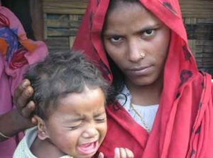 A Rohingya woman and her child