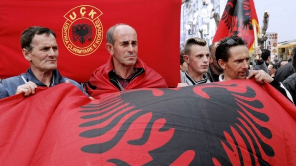 In early April 2013, ethnic Albanians in Kosovo carry the Albanian flag in protest of talks between Kosovo and Serb leaders. The EU-mediated session did not lead to a resolution of the status of the contested territory. Photo credit: AFP PHOTO/ARMEND NIMANI