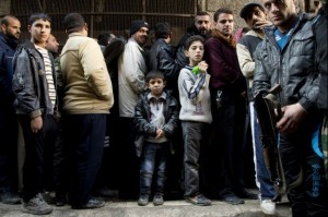 syria_boy_stands_in_bread_line_1209