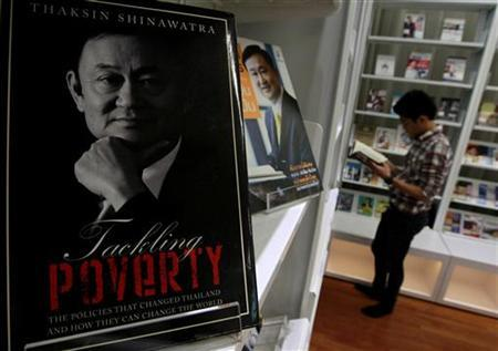 A book about Thailand's former PM Thaksin is displayed at the Puea Thai Party headquarters in Bangkok