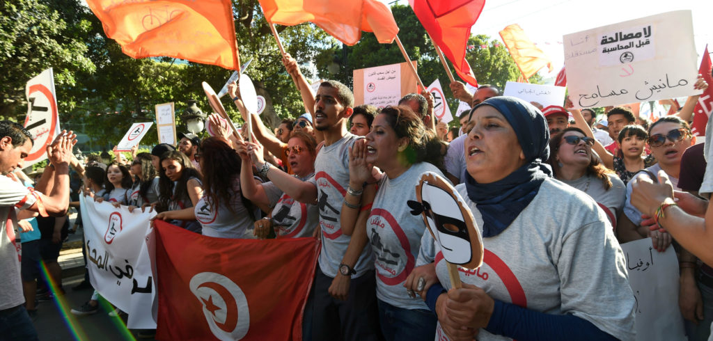 Tunisians protest an economic reconciliation bill proposed by the coalition government in July 2016. Remarkably, democracy has taken hold in Tunisia just 5 years after the Arab Spring, but its success is not assured. Photo: FETHI BELAID/AFP/Getty Images