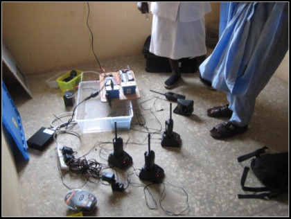 "2-way radios being charged by ""solar suitcase"" power"