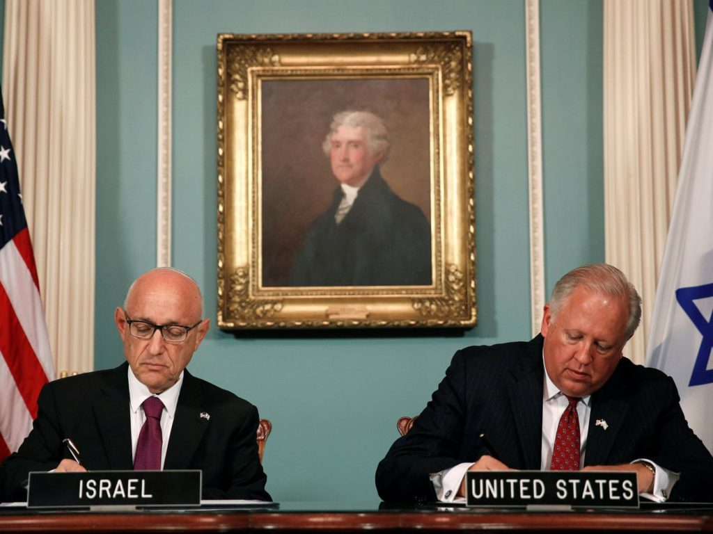 U.S. and Israeli representatives signing a memorandum of understanding in Washington on September 14. (Reuters)