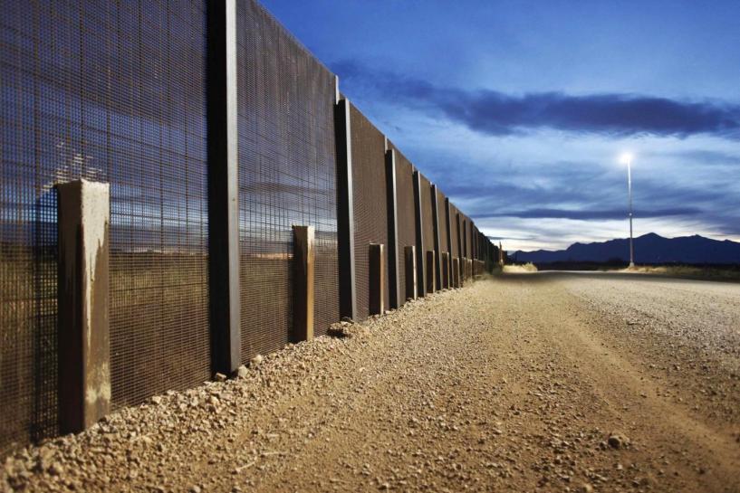 The Arizona-Mexico border fence is seen near Naco, Arizona, March 29, 2013. REUTERS/Samantha Sais/File photo