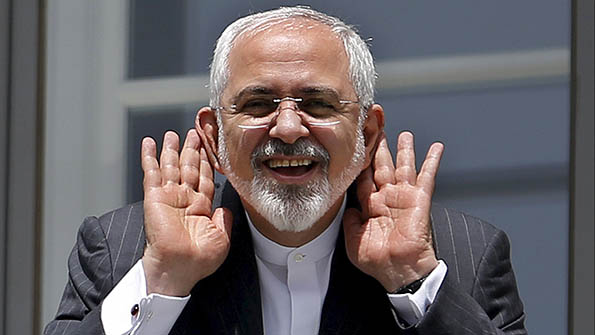 "Iranian Foreign Minister Mohammad Javad Zarif gestures as he talks with journalist from a balcony of the Palais Coburg hotel where the Iran nuclear talks meetings are being held in Vienna, Austria July 10, 2015. Iran accused major powers on Friday of backtracking on previous pledges and throwing up new ""red lines"" at nuclear talks, after the deadline to reach an agreement in time to receive expedited scrutiny from the U.S. Congress expired with no deal. (REUTERS/Carlos Barria)"